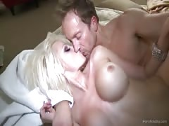 Fake-tit blonde jumping on a huge dick in Porn Fidelity video