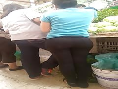 wide plump latina bubble in black tight pants